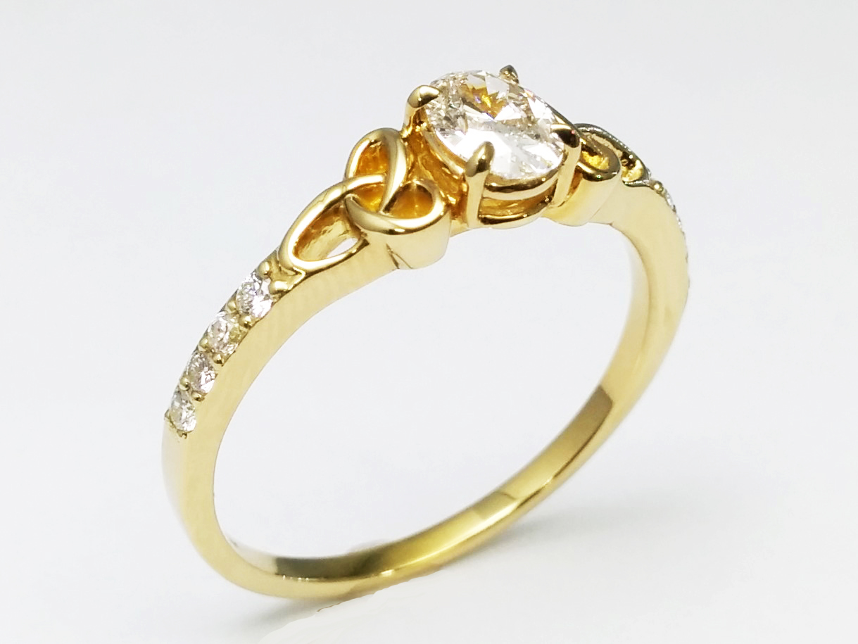 Oval Diamond Celtic Knot Engagement Ring in 14K Yellow Gold Band