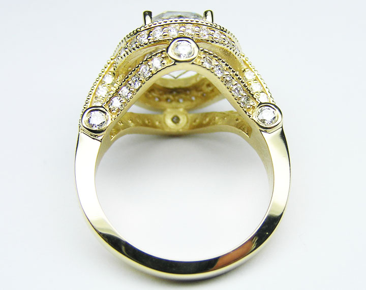 Oval Diamond Legacy Style Engagement Ring 0.57 tcw. In 14K Yellow Gold