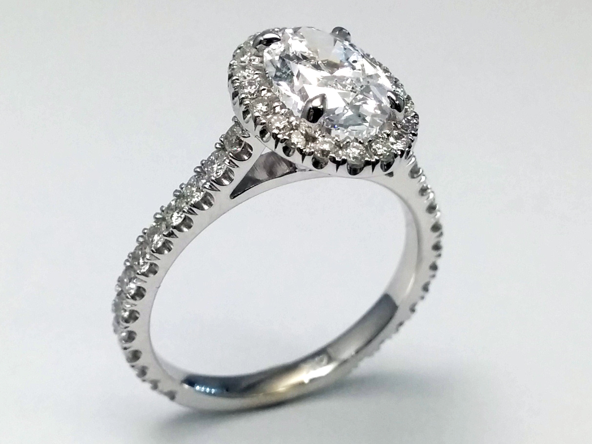 Cathedral Oval Diamond Ring with a Diamond Halo in White Gold