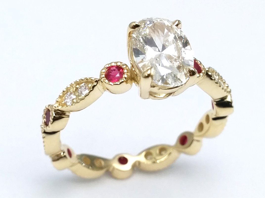 Oval Diamond With Round Diamonds & Ruby Accents in 14k Yellow Gold