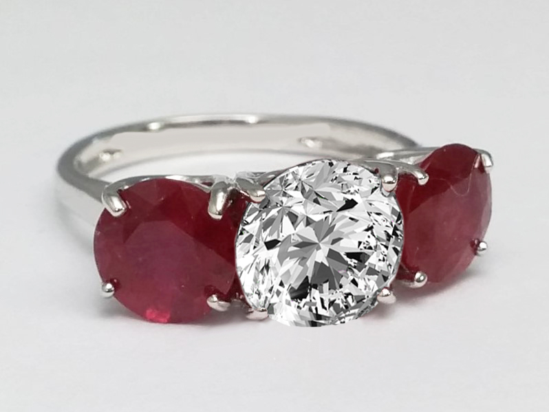 Three Stone Ruby Engagement Ring in 14 Karat White Gold