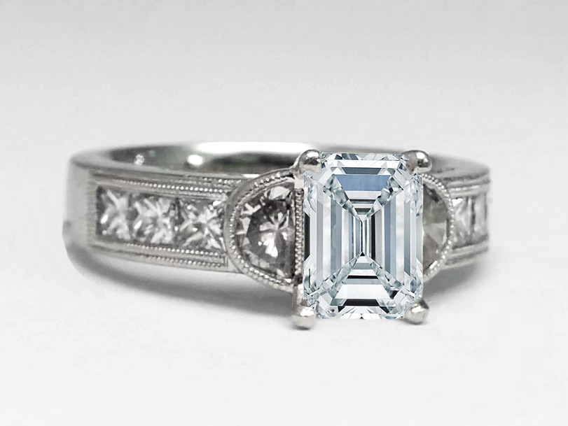 Emerald cut diamond half moon engagement Ring & princess accents