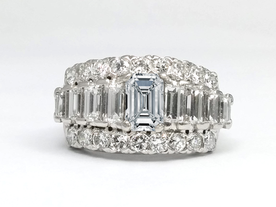 Emerald cut diamond with baguettes cut diamond accents