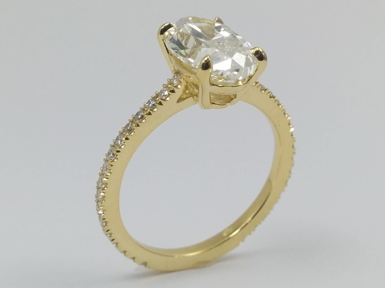 Petite Oval Diamond Engagement Ring in Yellow Gold