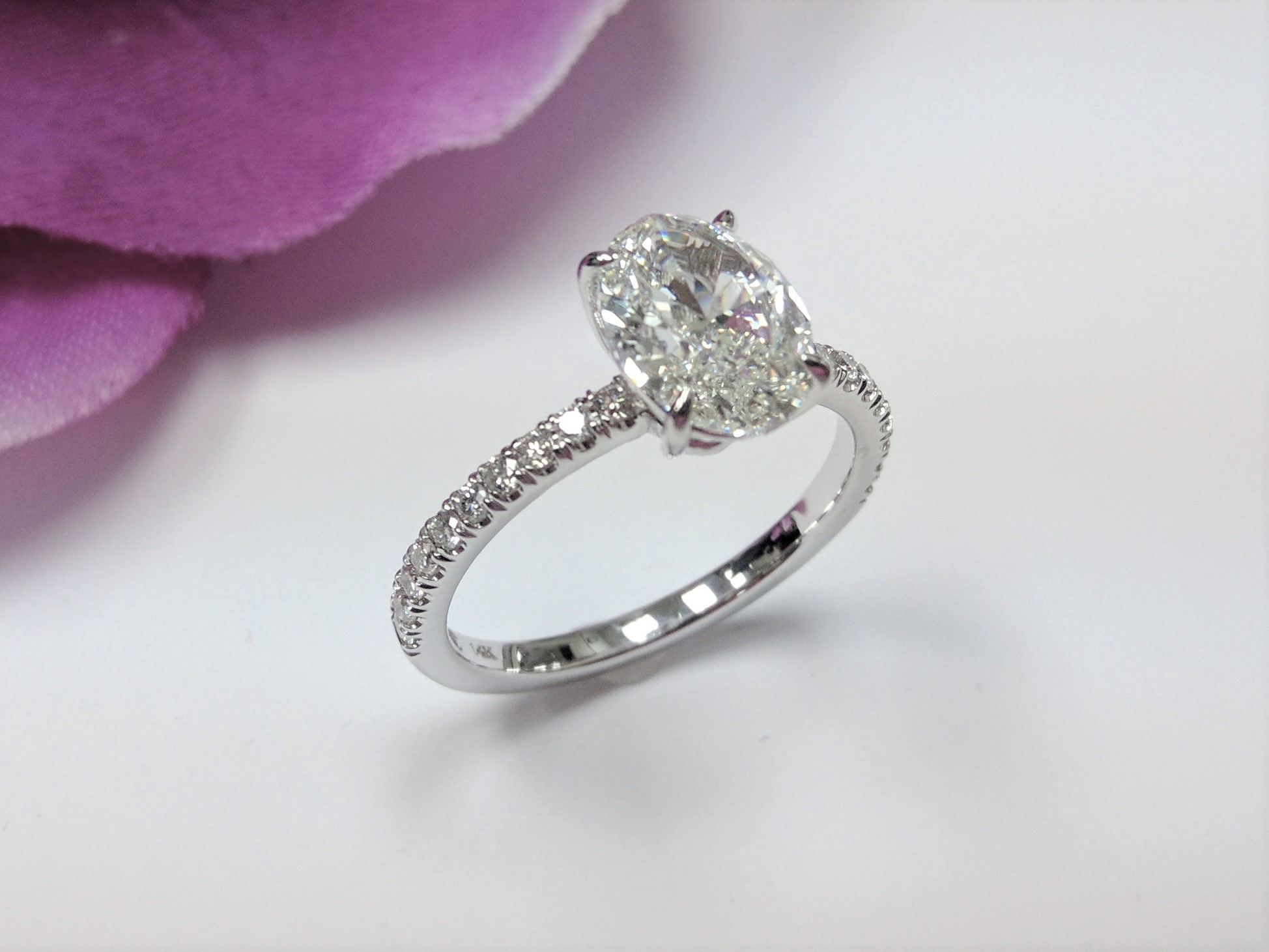 Delicate Low Profile Oval Diamond Engagement Ring