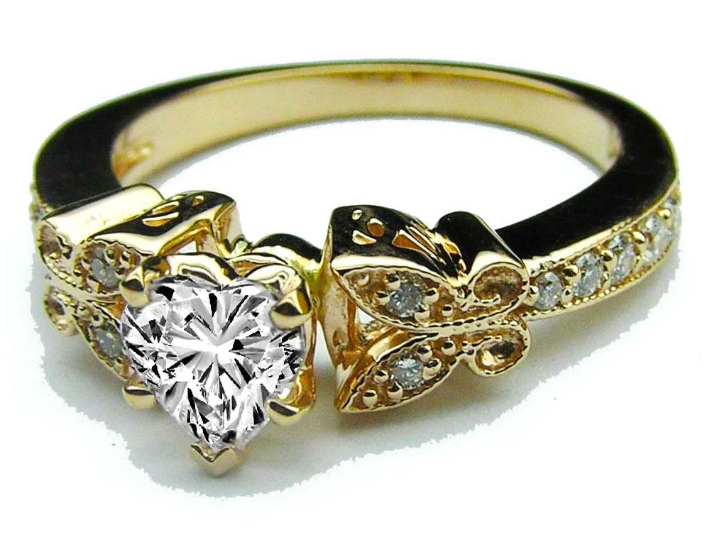 Heart Shape Diamond Butterfly Vintage Engagement Ring  0.16 tcw. In Yellow Gold