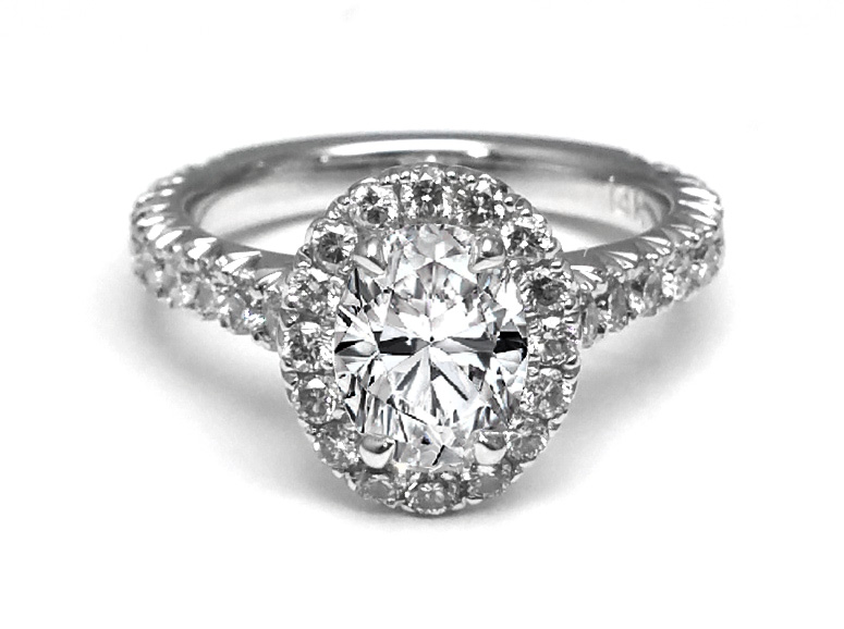 Cathedral Oval Diamond Ring with a Diamond Frame in White Gold