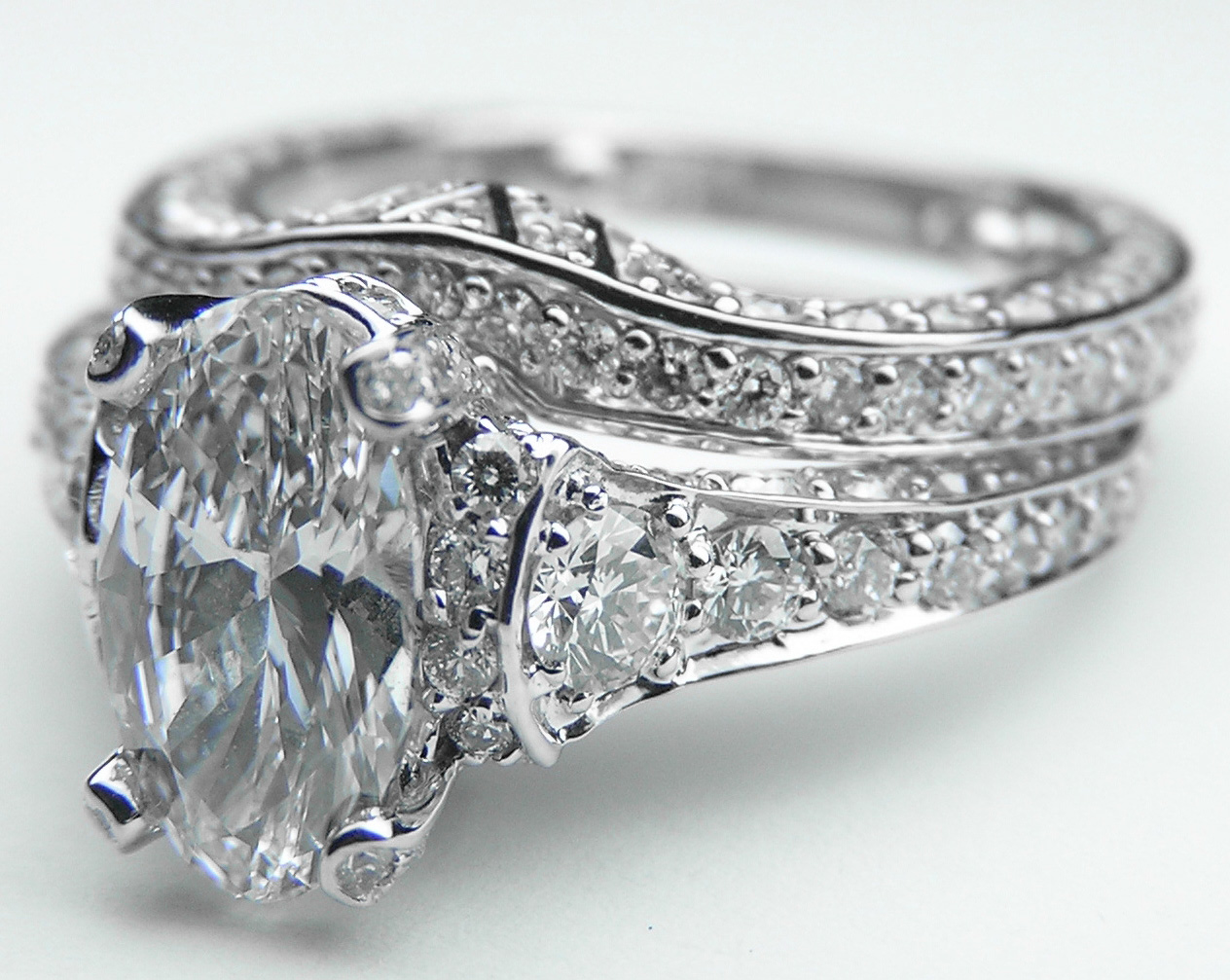 Large Oval Diamond Cathedral Graduated Pave Bridal Set In 14K White Gold